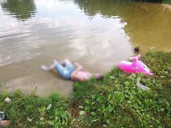 Отдыхающие достали из пруда утопленника
